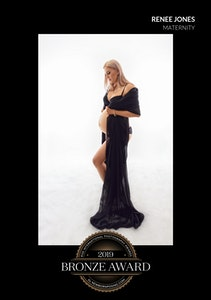 2019 Bronze Award Rise International Photography Award Image Certificate for a backlit image of a pregnant mum wearing a black gown with open front