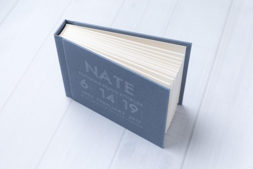 Customized matted linen newborn album