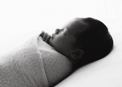 black and white side view of a newborn baby sleeping, backlit side profile of newborn baby